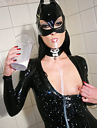 Latex catwoman bathes in milk