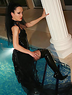 Gothic Mistress gets wet in PVC