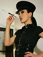 Kinky and smoking female officer