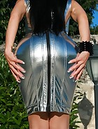Seduction in a silver PVC dress