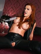 Redhead Geena's leather fuck hole