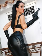 Femme Fatale in tight black leather