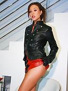 Natalia Forrest in leather mini