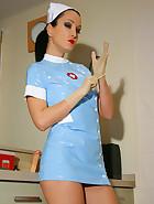 Kinky nurse plays with a big toy