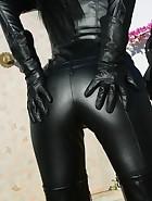 Leather Domina trains human dog