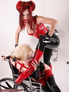 Girl-Girl Rubber Domination