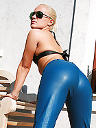 Blonde gets cum on her leather ass