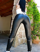 Outdoors in tight leather pants