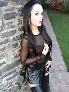 Short leather skirt tease outdoors