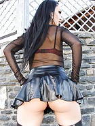 Short leather skirt tease outdoors