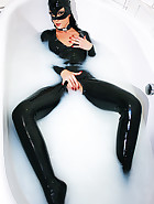Latex catwoman bathes in milk, pic #13