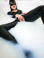 Latex catwoman bathes in milk, pic #14