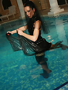 Gothic Mistress gets wet in PVC, pic #11