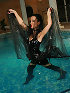 Gothic Mistress gets wet in PVC, pic #10