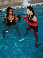 Wet lesbian catfight in shiny PVC, pic #8