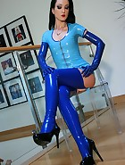 Riding a big dildo in blue latex, pic #3