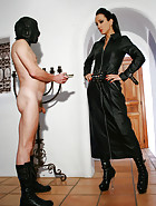 Leather Domina uses sub as ashtray, pic #1