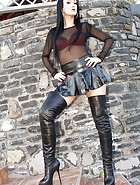 Short leather skirt tease outdoors, pic #1
