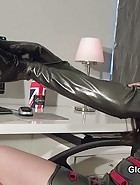 Wetting her latex gloves, pic #1